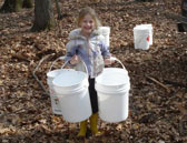 girl-with-syrup-buckets_website